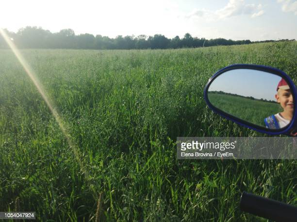 Reflection Of Boy In Side-View Mirror