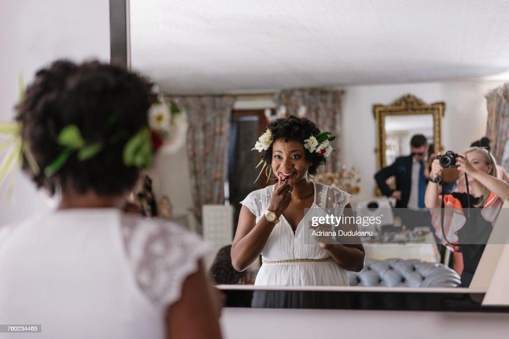 Reflection Of Bride Applying Lipstick While Standing In Front Of Mirror : Bildbanksbilder