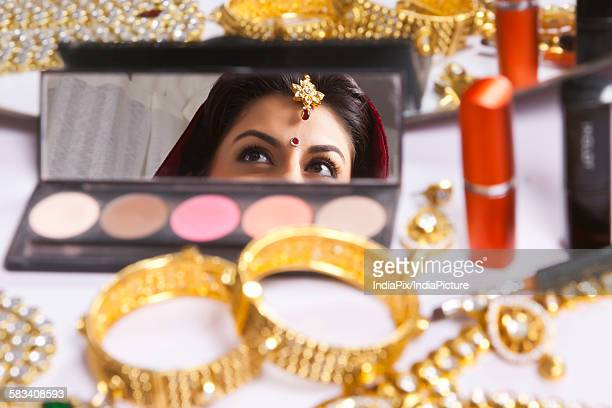 Reflection of brides eyes in makeup mirror
