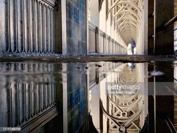 reflection of bridge in puddle - newcastle upon tyne stock pictures, royalty-free photos & images