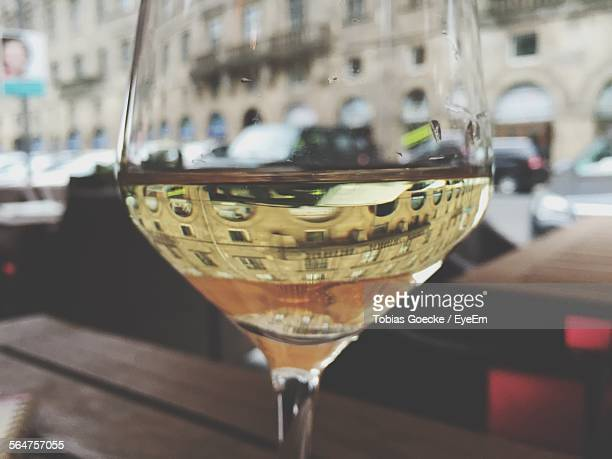 Reflection Of Building In Glass Of White Wine