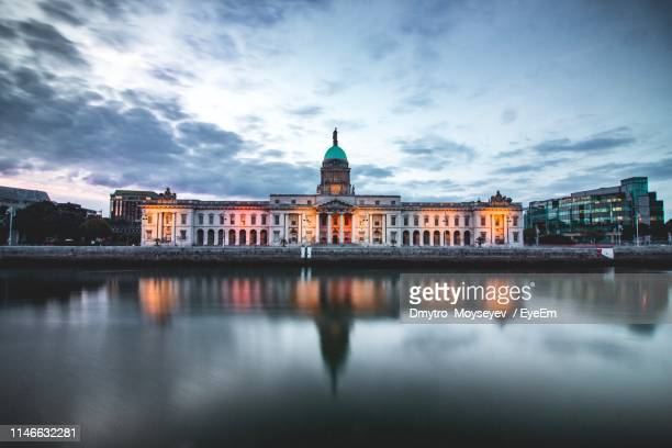 reflection of building in river against sky - dublin republic of ireland stock pictures, royalty-free photos & images