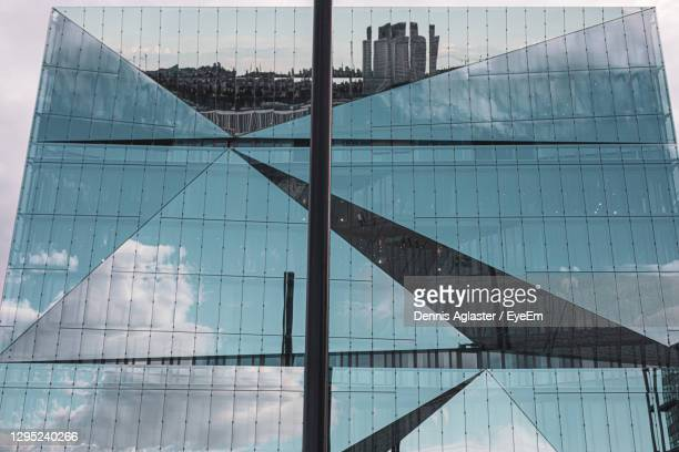 reflection of building on glass - headquarters stock pictures, royalty-free photos & images