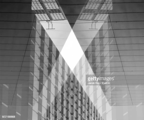 Reflection Of Building On Glass