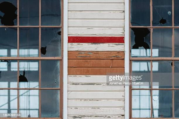 reflection of building on glass window - 2007 stock pictures, royalty-free photos & images
