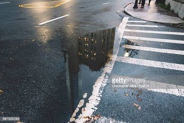Reflection Of Building On Puddle During Monsoon