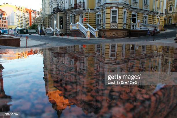 Reflection Of Building On Water In City