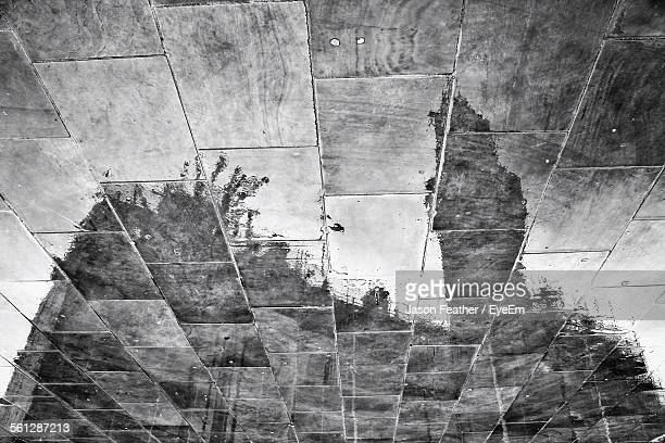 reflection of building on wet tiled floor - bradford england stock pictures, royalty-free photos & images