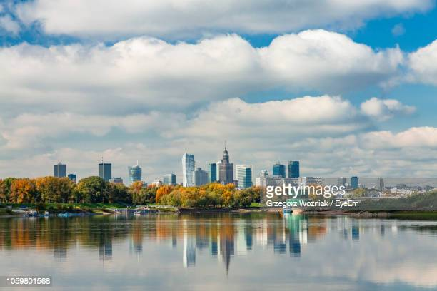 reflection of buildings in city against sky - warsaw stock pictures, royalty-free photos & images