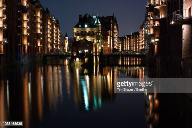 Reflection Of Buildings In City At Night