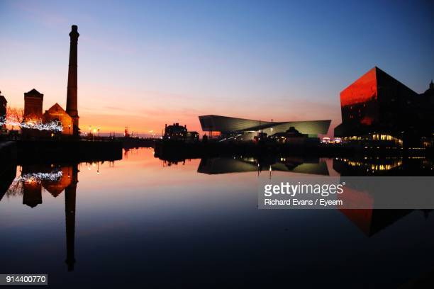 reflection of buildings in city at night - waterfront stock pictures, royalty-free photos & images