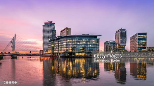 reflection of buildings in city at waterfront - manchester england stock pictures, royalty-free photos & images