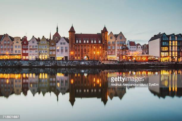 reflection of buildings in city at waterfront - gdansk stock pictures, royalty-free photos & images