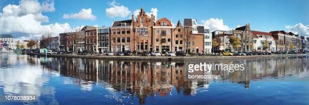 reflection of buildings in city - haarlem fotografías e imágenes de stock