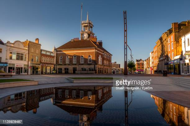 reflection of buildings in city - stockton on tees stock pictures, royalty-free photos & images