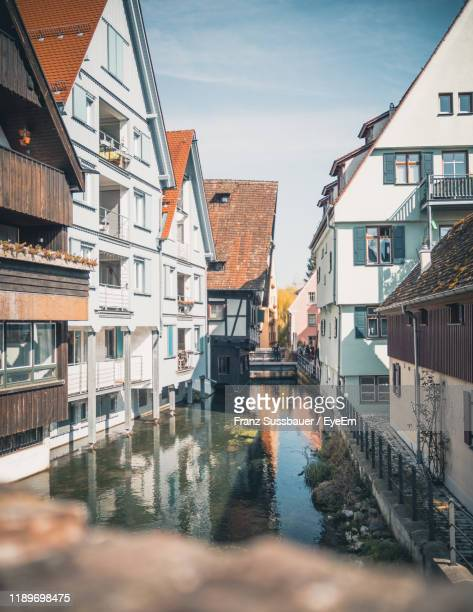 reflection of buildings in city - ulm stock pictures, royalty-free photos & images