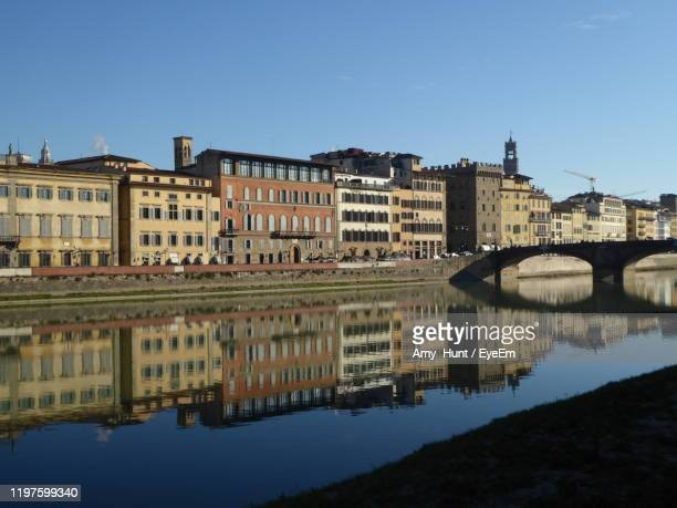 reflection of buildings in city - amy hunt stock pictures, royalty-free photos & images