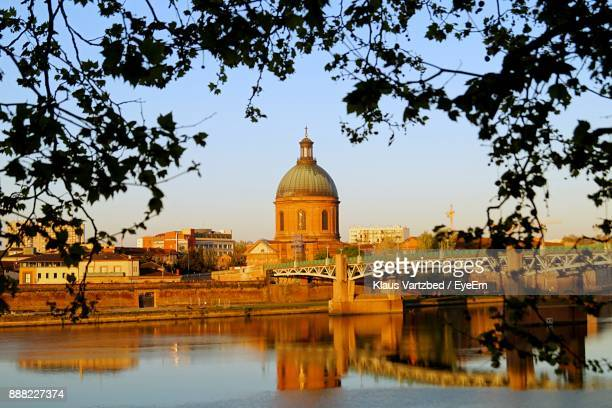 reflection of buildings in city - toulouse stock pictures, royalty-free photos & images