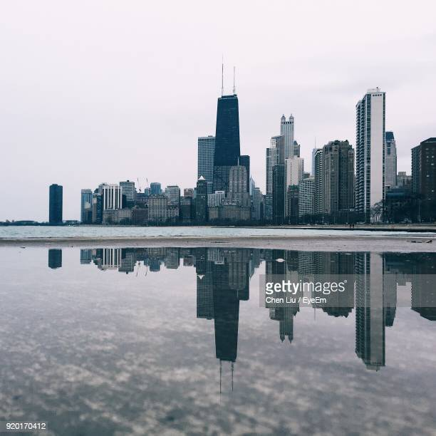 reflection of buildings in city - chicago stock pictures, royalty-free photos & images