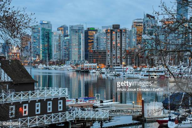 reflection of buildings in city - richmond british columbia stock photos and pictures