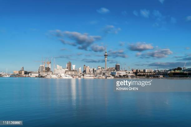 reflection of buildings in lake against sky in auckland city - auckland stock pictures, royalty-free photos & images