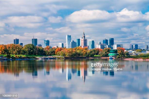 reflection of buildings in lake against sky - warsaw stock pictures, royalty-free photos & images