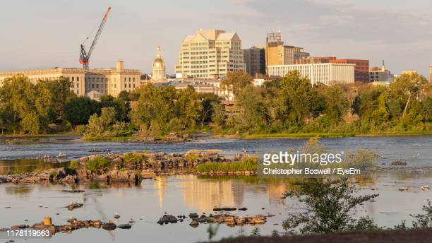 reflection of buildings in lake - trenton new jersey stock pictures, royalty-free photos & images