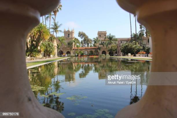 reflection of buildings in lake - balboa park stock photos and pictures