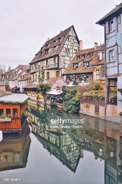 reflection of buildings in river against clear sky - strasbourg stock pictures, royalty-free photos & images