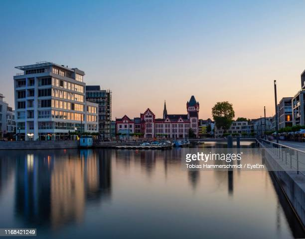 reflection of buildings in river against sky - dortmund city stock pictures, royalty-free photos & images