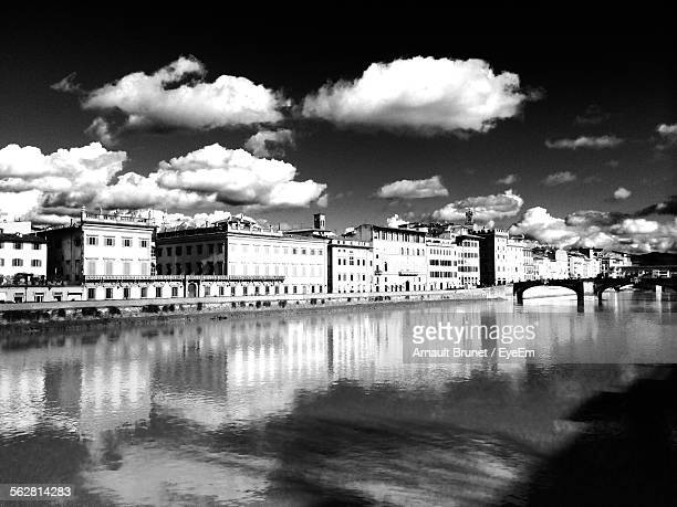 reflection of buildings in river against sky - arnault stock pictures, royalty-free photos & images