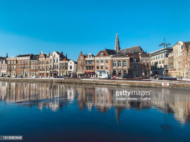 reflection of buildings in river - bortes stock pictures, royalty-free photos & images