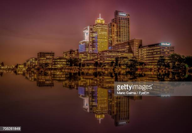 Reflection Of Buildings In Water At Night
