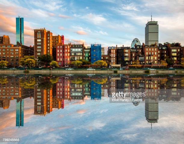 reflection of buildings in water - boston stock pictures, royalty-free photos & images