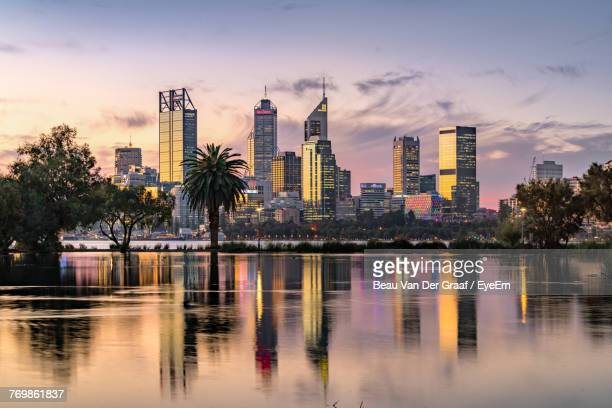 reflection of buildings in water - perth australia stock photos and pictures
