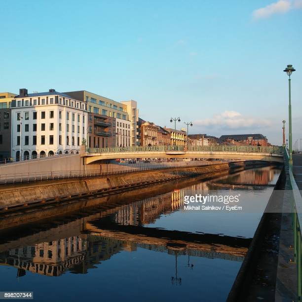 reflection of buildings in water - charleroi stock pictures, royalty-free photos & images