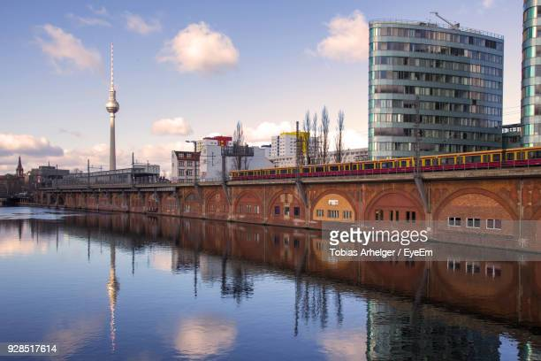 reflection of buildings in water - spree river stock pictures, royalty-free photos & images