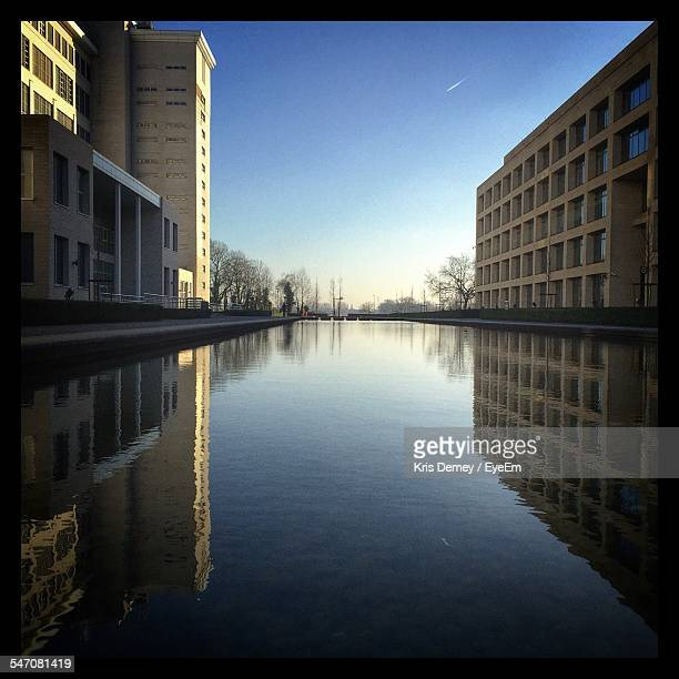 Reflection Of Buildings On Artificial Pond