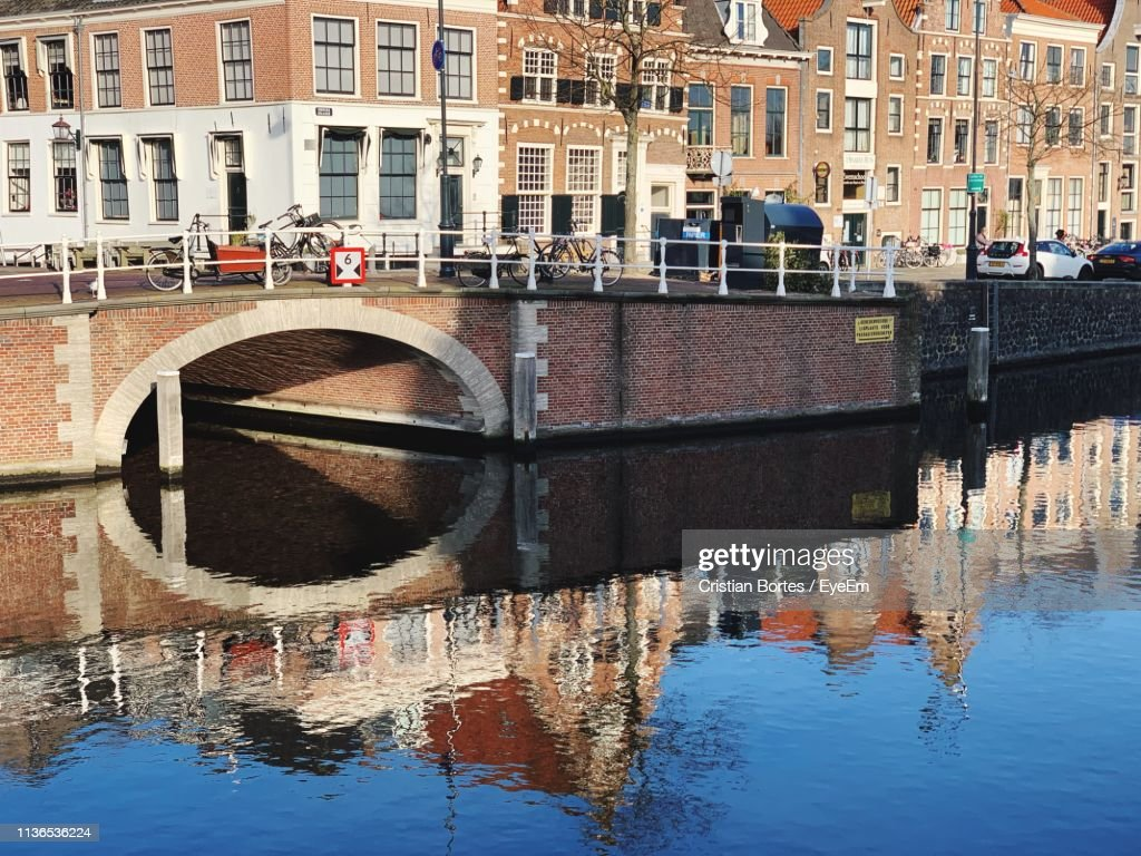 Reflection Of Buildings On Canal In City : Stock Photo