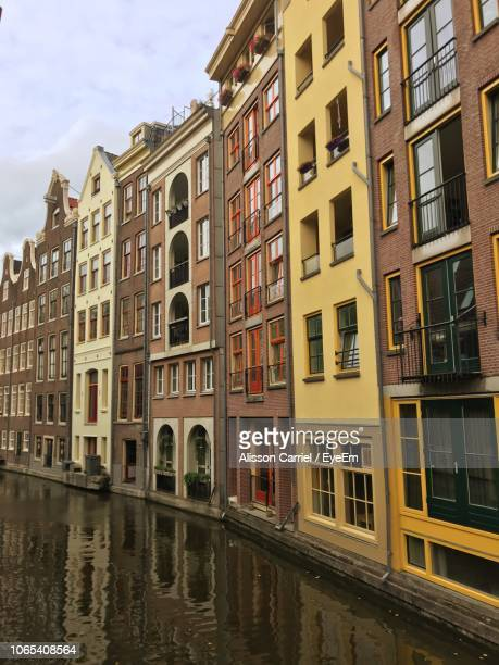 reflection of buildings on water - alisson stock pictures, royalty-free photos & images
