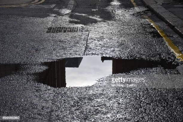 reflection of built structure in water - puddle stock pictures, royalty-free photos & images