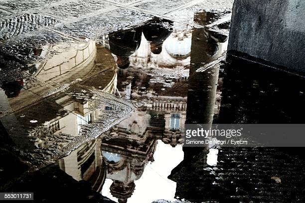 Reflection Of Built Structures In Puddle