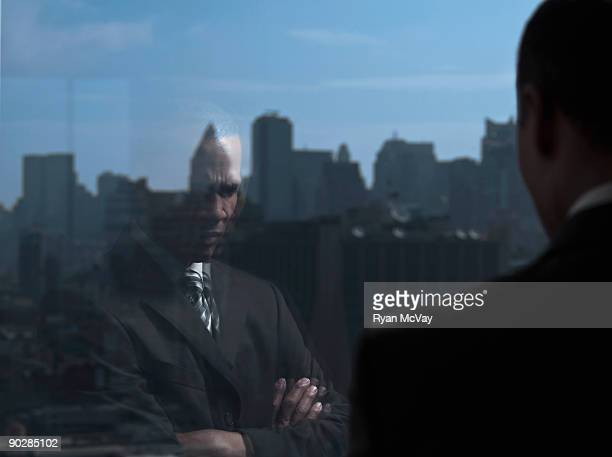 Reflection of business man in deep thought