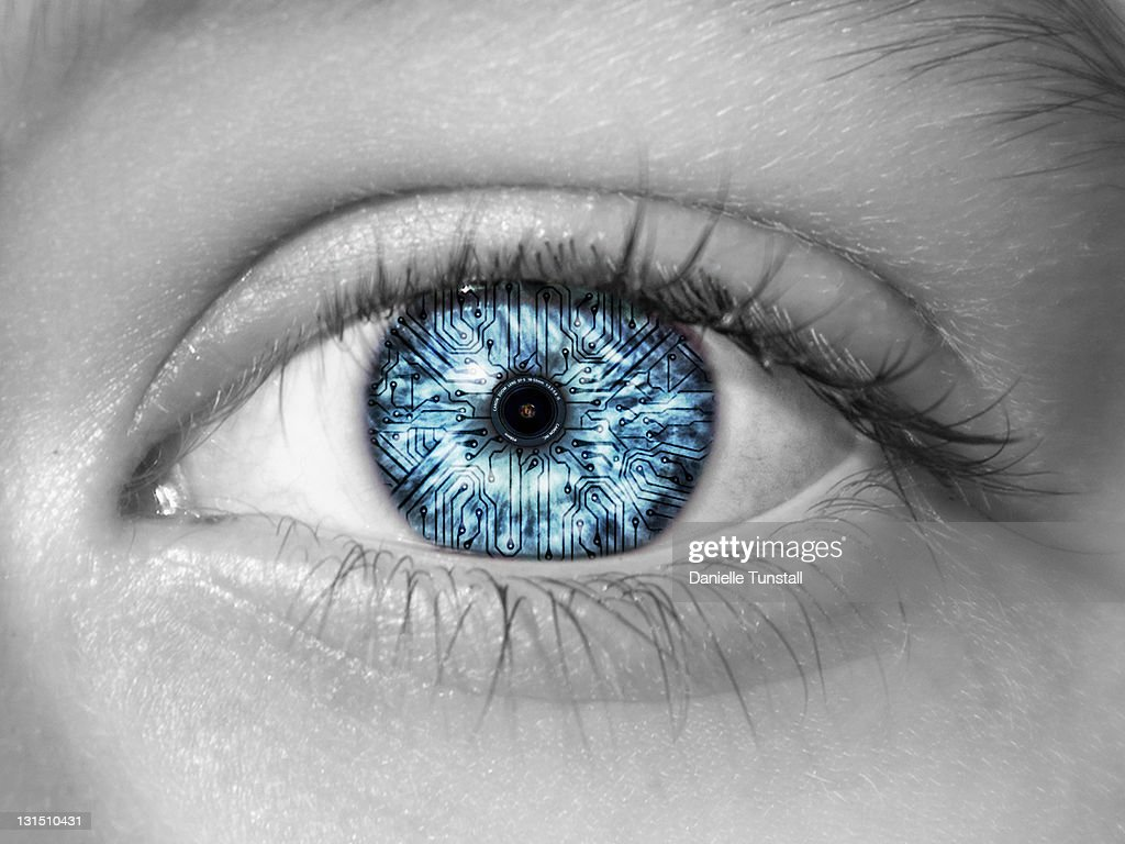 Reflection of camera lens in eye : Stock Photo