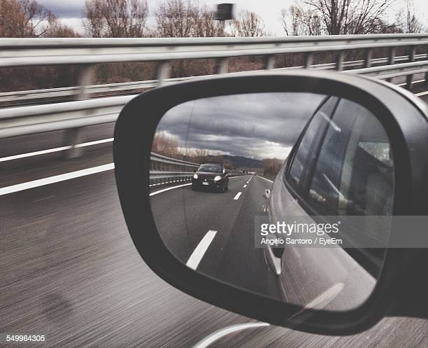 Reflection Of Car In Rear View Mirror