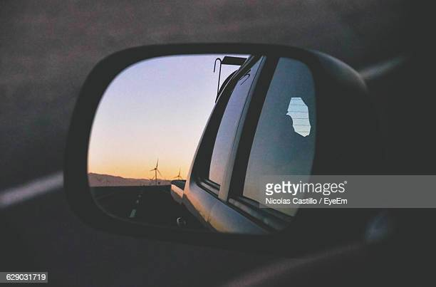 Reflection Of Car On Road