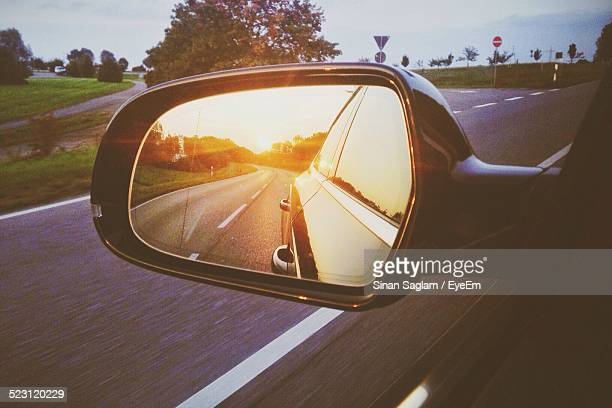 reflection of car on side-view mirror on country road - side view mirror stock photos and pictures