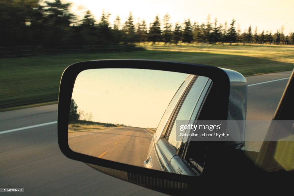 Reflection Of Car On Side-View Mirror : Stock Photo