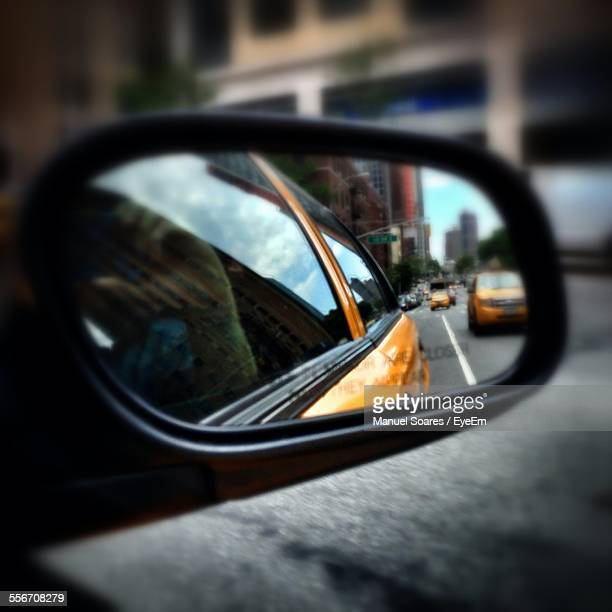 reflection of cars on city street in side-view mirror - side view mirror stock photos and pictures