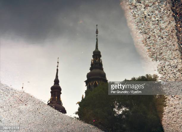 Reflection Of Cathedral In Puddle